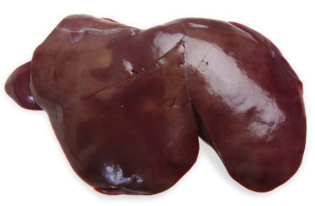An entire raw lambs liver with a light shadow over a white background.