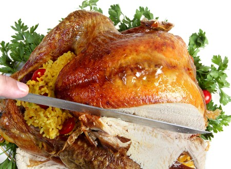 Carving a roast turkey for christmas or thanksgiving photo