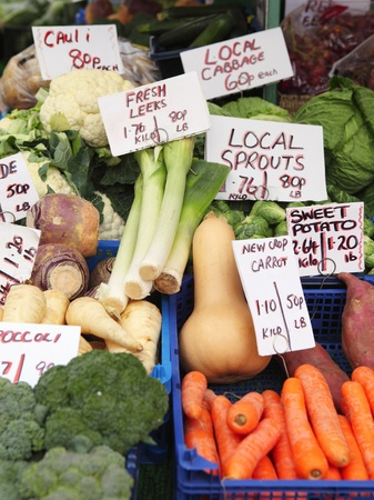 produces: A display of fresh English vegetable produce on a market stall in Great Yarmouth, Norfolk, England