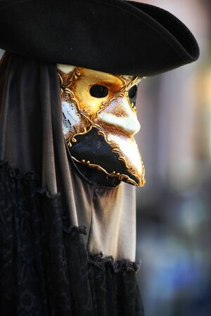 carnevale: A mans mask and hat for the Venice Carnevale that takes place in the 10 days before Lent