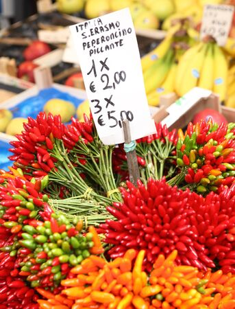 bundles of hot chillies on sale at a vegetable stall in the Rialto Market, Venice. photo