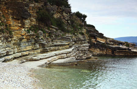 tectonics: Limestones unconformably overlaid by shales with  faulting (centre right) and evidence of tectonic activity, in northern Corfu (Kerkyra), Greece