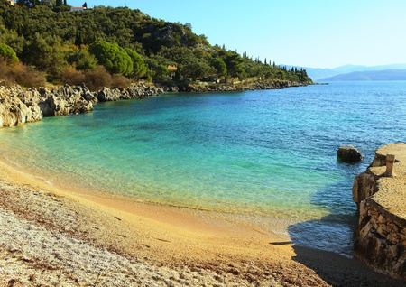 ultramarine blue: The small but delightful beach at Nissaki on the north-east coast of Corfu island, Greece, Stock Photo