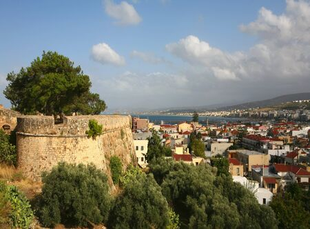 fortezza: A panoramic view of Rethymnon city on Crete, Greece, with part of the Fortezza castle wall on the left.