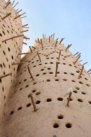 A traditional Arabian pigeon house, or dovecote, at the Katara traditional village in West Bay, Doha, Qatar, Arabia Stock Photo - 8789562