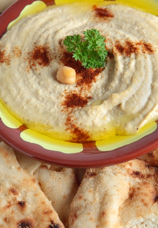 The traditional Middle Eastern chickpea dip, hummus with tahini, served with Egyptian flat bread.
