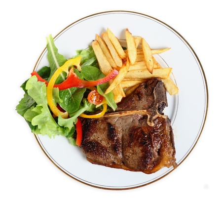 steak dinner: View from above of a meal of T-bone steak, salad and french fries