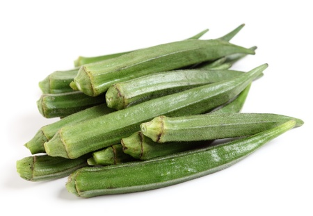A heap of okra or ladies fingers on a white background
