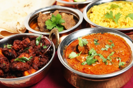 köri: Chicken fry (left) and Kashmiri lamb curry (right) in front of chapattis, beef korma and saffron rice.