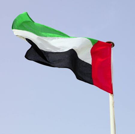flagpoles: The national flag of the United Arab Emirates in Arabia.