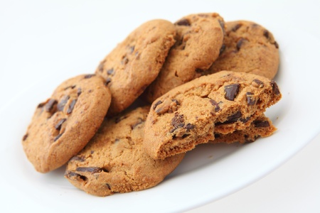 chocolate chip cookies: A plate of homemade chocolate chip cookies on a white background
