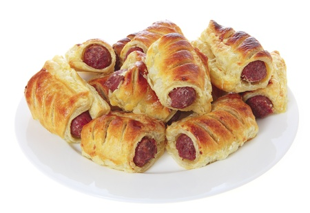 white sausage: Sausage rolls on a white plate