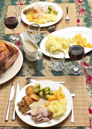 swede: A traditional festive dinner of turkey, roast and boiled potatoes, brussels sprout, swede, stuffing and gravy