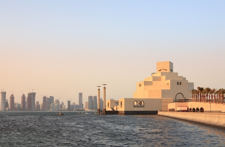 qatar: The Museum of Islamic Art in Doha, Qatar, at sunset with the emerging high-rise skyline behind it, photographed in November 2008. Stock Photo