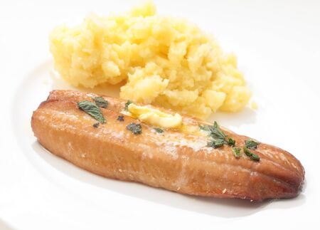 kipper: A grilled smoked herring or kipper, garnished with  herbs and a dab of butter, served with mashed boiled potatoes