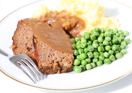 meatloaf: A dinner of meatloaf, peas, mashed potato and gravy - and old favourite. Stock Photo