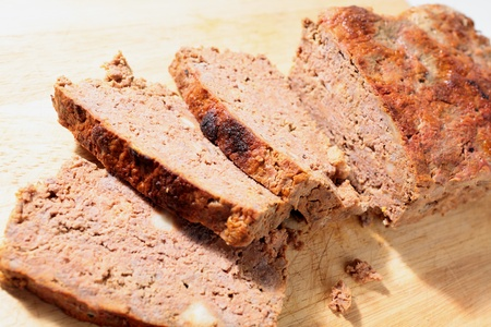 meatloaf: Homemade meatloaf slices on chopping board