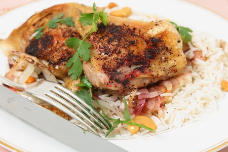 chicken rice: A meal of Lebanese-style grilled sumac chicken with onion on pitta, on a bed of cashew and walnut rice, garnished with coriander