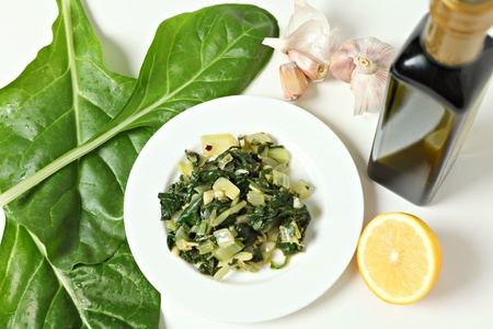 then: A side dish of swiss chard cooked in olive oil with garlic and chilli flakes and then tossed in lemon juice, with raw ingredients