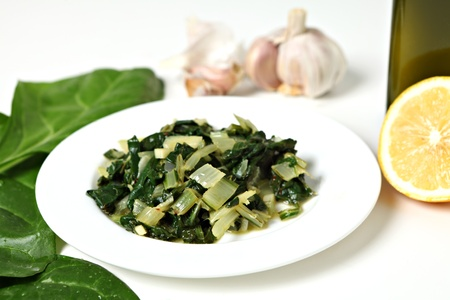 chard: A side dish of swiss chard cooked in olive oil with garlic and chilli flakes and then tossed in lemon juice, with raw ingredients