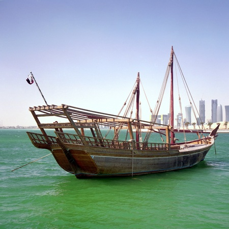 qatar: An Arab boom or boum, one of the larger traditional trading ships from the Arabian Gulf, in Doha Bay, Qatar, March 2010.
