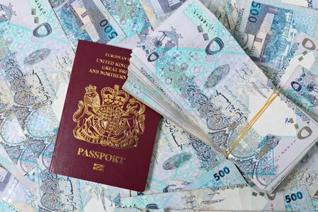 stash: A British passport mixed in with a stash of high-value Qatari banknotes worth about $20,000 - a business opportunity, perhaps.