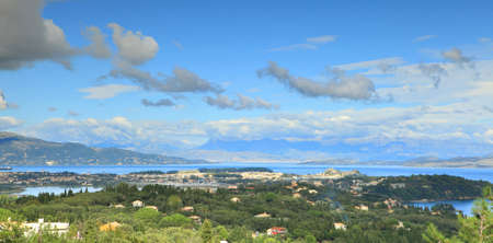 corfu: A view across Corfu town in autumn, with the hills of northern Kerkyra (Corfu) on the left and the hills of Albania and mainland Greece in the distance.
