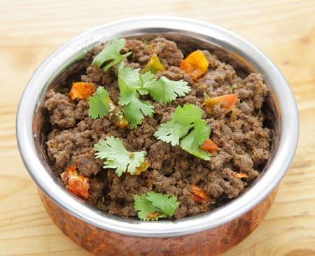 minced: A minced beef or keema curry in a serving bowl, garnished with coriander leaves