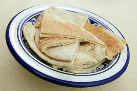 A bowl with everyday Arab or Egyptian flat bread, known as kubz Stock Photo - 14070460