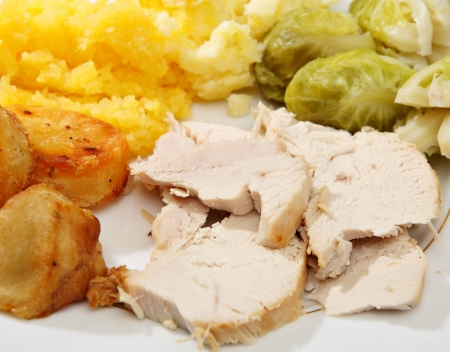 swede: A typical English Christmas dinner of turkey, boiled swede, Brussels sprouts, roasted and mashed potato