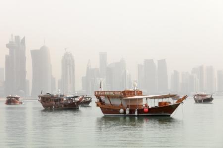 postmodern: Dhows in Doha Bay, Qatar, June 2012, with the Arab capital
