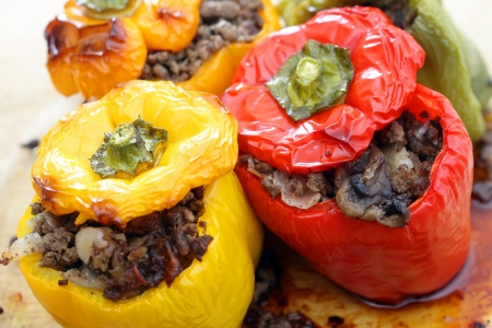 bell peppers: Colourful bell peppers or capsicums stuffed with a filling of ground beef, mushroom, onion and celery, straight from the oven