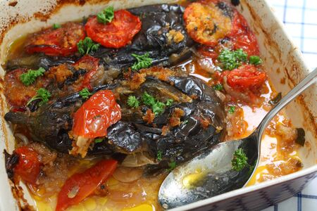 imam: The Greek and Turkish speciality Imam Baildi, eggplant baked in olive oil with onion, tomato, garlic, parsley, topped with bread crumbs  Stock Photo