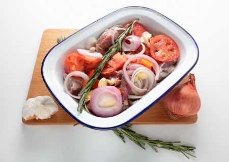 ovenbaked: Traditional Greek kleftiko, an oven-baked lamb stew with lemon, olive oil, onion, carrot, garlic and herbs ready for the oven  Recipes vary according to availability and can include feta and potatoes