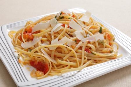 slivers: Linguine pasta tossed in a sauce of olive oil, tomato, garlic and basil and topped with slivers of parmasan cheese