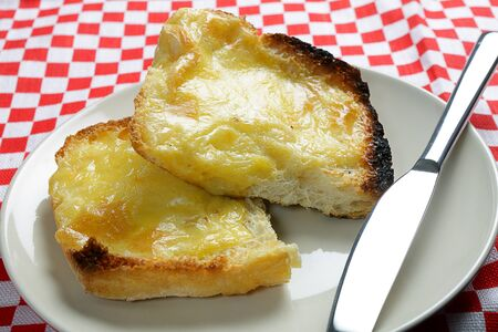british food: A Welsh rabbit, or Welsh rarebit - a mix of cheddar cheese and egg with mustard, pepper and salt on toast