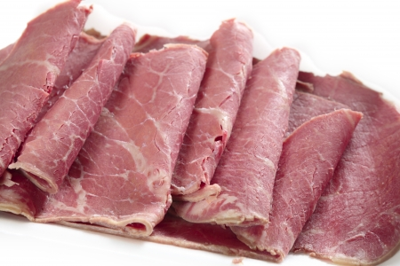 processed: American-style corned beef closeup, with the slices folded back Stock Photo
