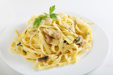 AI: Ribbon pasta with mushrooms and italian parsley, fettuccine ai funghi, topped with curls of parmesan reggiano