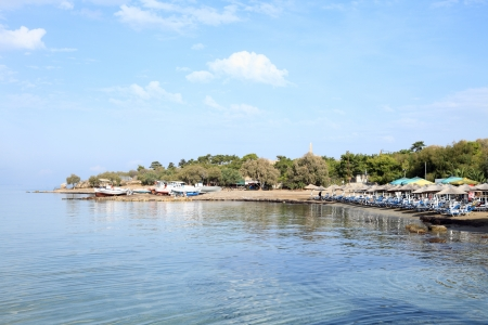 Aegina Town beach beside the small boat repair area and in the shadow of the ruins of ancient Aegina and the temple of Apollo photo
