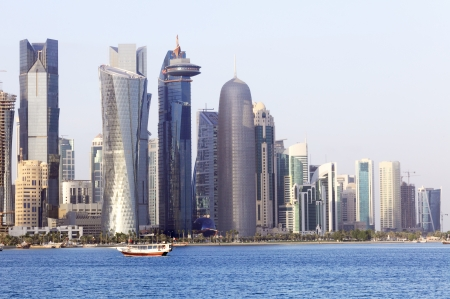 Doha Bay with a dhow in front of the huge towers