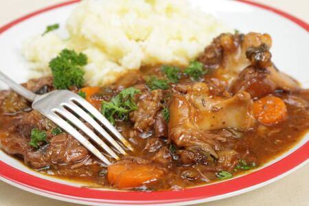 beef stew: Traditional British oxtail stew served with mashed potato
