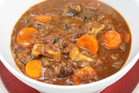 stew: A serving bowl full of freshly home-made oxtail stew, a delicious traditional British or European food.