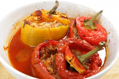capsicums: A bowl of peppers stuffed with rice and minced beef and cooked in a tomato sauce