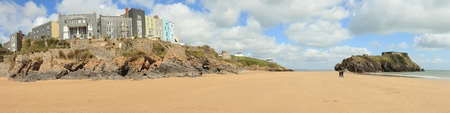 tenby wales: The main beach at Tenby, in West Wales, with its row of Victorian or Edwardian era hotels looking out from The Esplanade over the sands and the small island topped with an old fortification on the right