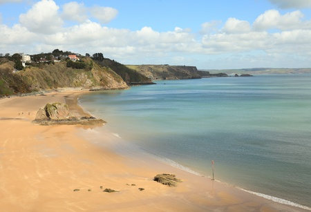 tenby wales: A view of the beach at Tenby, in Pembrokeshire, West Wales, shortly before the start of the holiday season