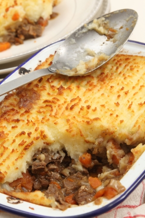 minced pie: Homemade cottage pie, made with finely chopped cooked meat, onion and carrot, topped with mashed potato and baked until golden  This particular dish is slighly unusual, as it is made with ox tongue rather than minced beef - but it looks the same as any co Stock Photo