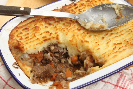 Homemade cottage pie, made with finely chopped cooked meat, onion and carrot, topped with mashed potato and baked until golden  This particular dish is slighly unusual, as it is made with ox tongue rather than minced beef - but it looks the same as any co photo