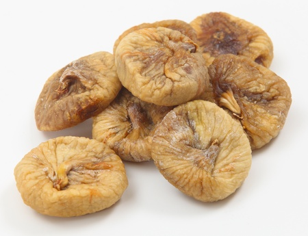 dried up: Dried figs in a pile on a white background