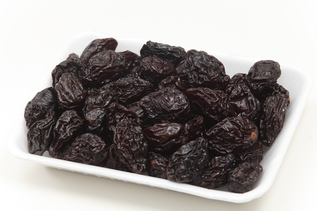 laxative: Prunes in a supermarket tray
