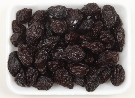 laxative: Prunes in a supermarket tray from above Stock Photo